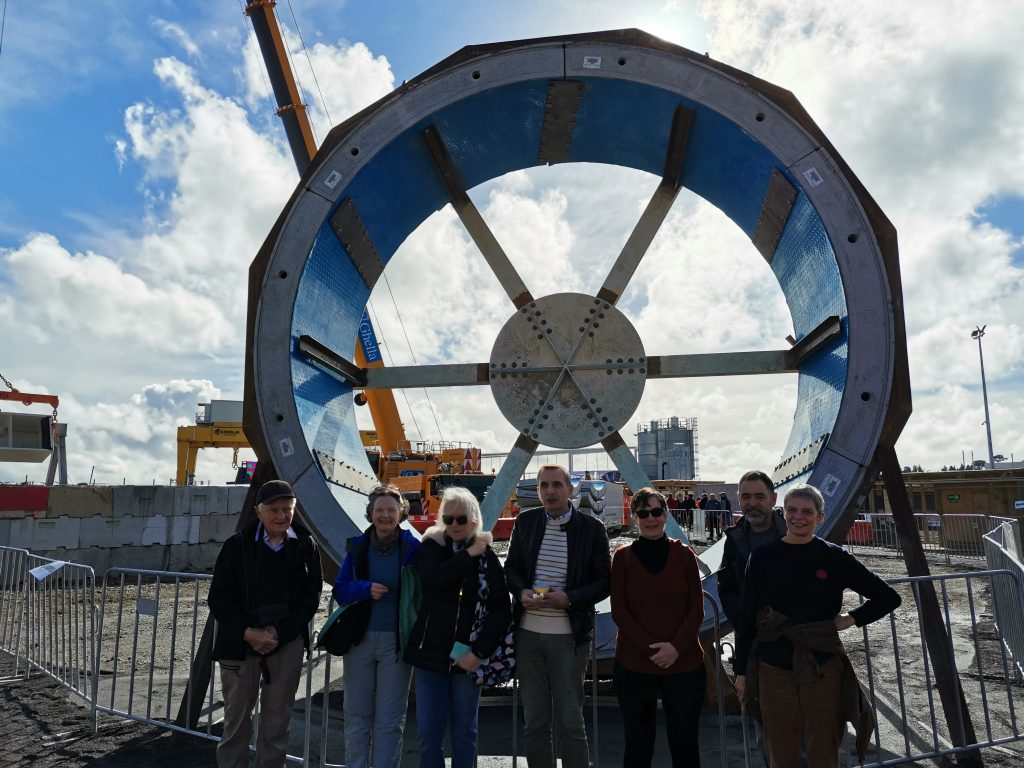 Roy, Liz Freddie, Trev, Chris, Damien and Mary - and segment ring which will form the tunnel.